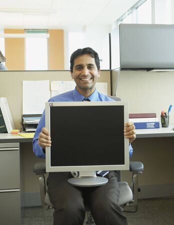 Businessman with computer monitor on lap Stock Photo - 16091556
