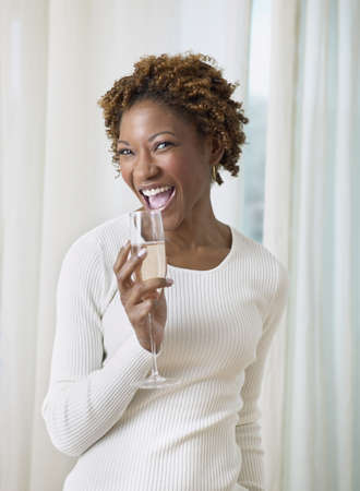 African woman smiling with champagne Stock Photo - 16091574