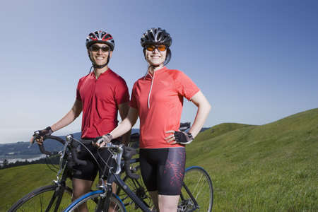 road cycling: Asian couple with bicycles in countryside