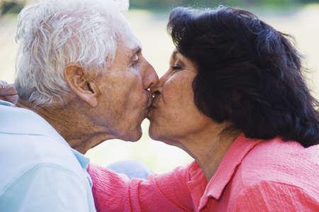 kisser: Senior Hispanic couple kissing