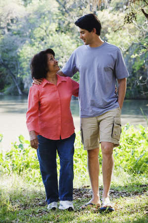 Hispanic mother and adult son walking outdoors Stock Photo - 16091602