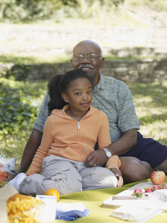 African grandfather and granddaughter at picnic Stock Photo - 16091616