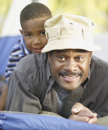 African father and son smiling Stock Photo - 16091619