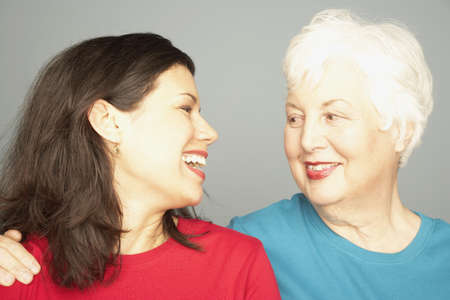 Mother and adult daughter smiling at each other Stock Photo - 16091653