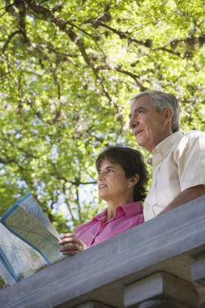 finding a mate: Senior couple with map outdoors