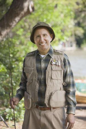 midsummer pole: Senior Hispanic man with fishing gear LANG_EVOIMAGES