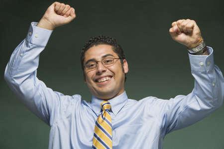 Hispanic businessman cheering Stock Photo - 16091710