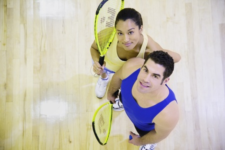 High angle view of man and woman with Squash rackets Stock Photo - 16091717