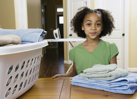 folding camera: African girl with folded laundry