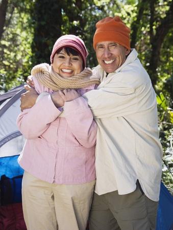 Senior couple hugging next to tent Stock Photo - 16091731