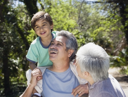 gaiety: Hispanic grandparents with grandson outdoors