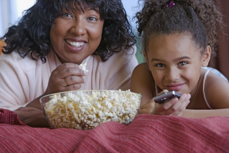 seeing: African mother and daughter eating popcorn