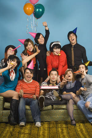 peruvian ethnicity: Group of young adults having birthday party LANG_EVOIMAGES