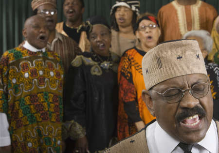 faithfulness: Group of middle-aged African people singing