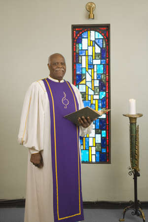 house robe: Senior African in church choir gown LANG_EVOIMAGES