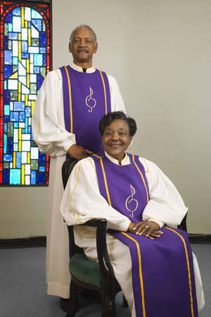 Senior African couple wearing church choir gowns Stock Photo - 16091816
