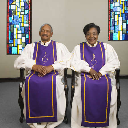 Senior African couple wearing church choir gowns Stock Photo - 16091686