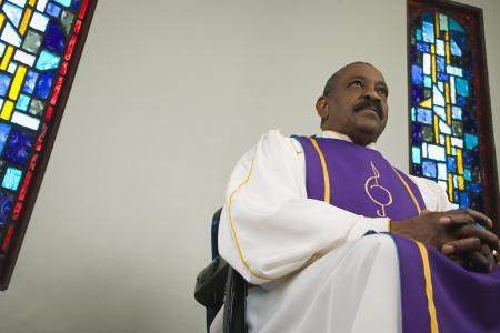 African man wearing church choir gown