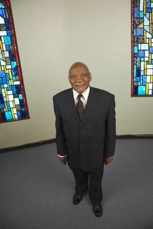 High angle view of senior African man next to stained glass windows Stock Photo - 16091826