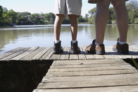 gaithersburg: Father and son standing on wooden dock