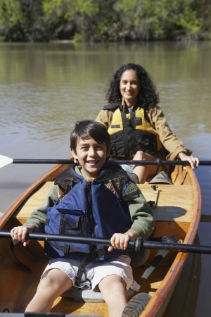 gaithersburg: Hispanic mother and son sitting in canoe
