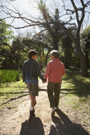 gaithersburg: Grandmother and grandson holding hands and walking in woods