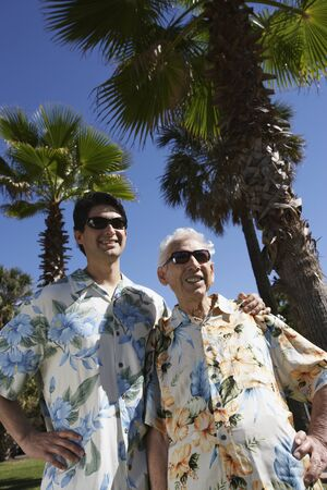 Father and adult son wearing sunglasses and Hawaiian shirts Stock Photo - 16091858
