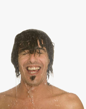 spattering: Man laughing in shower LANG_EVOIMAGES