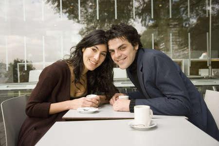 Hispanic couple smiling at cafe Stock Photo - 16091887