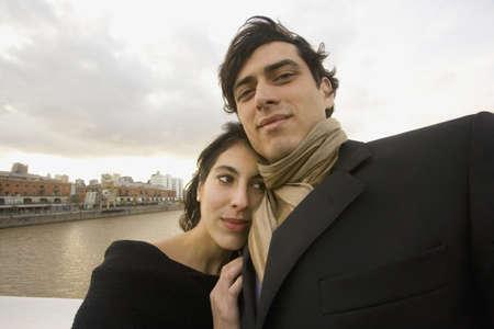 Hispanic couple hugging outdoors Stock Photo - 16091891
