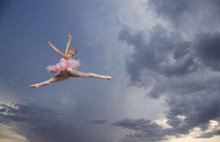 merry dancers: Female ballet dancer in mid air in sky