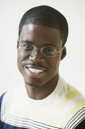 Close up of African man smiling and wearing eyeglasses Stock Photo - 16091921