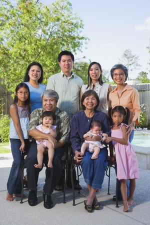 south american ethnicity: Multi-generational Asian family smiling outdoors LANG_EVOIMAGES
