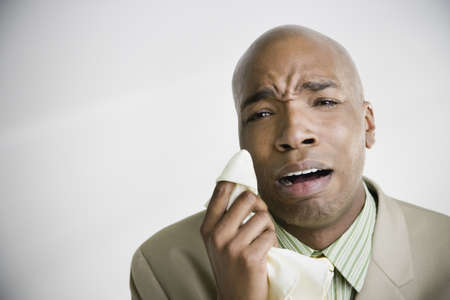 African businessman crying with tissue Stock Photo - 16091979