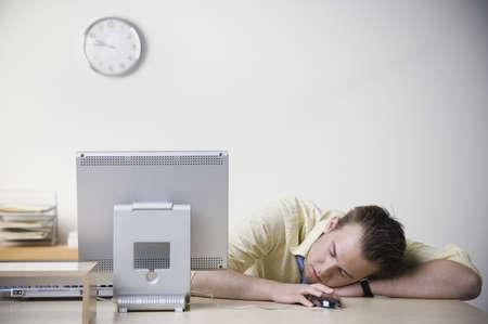 snoozing: Businessman sleeping on desk