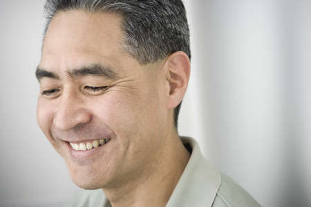only mid adult men: Middle-aged Asian man smiling