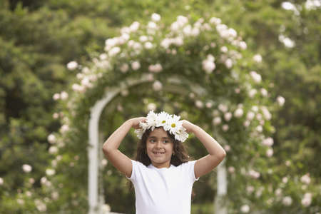 flowergirl: Young Hispanic girl with flower garland on head