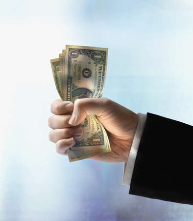 Businessman's hand holding US dollars Stock Photo - 16092031
