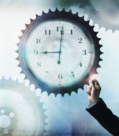 digitally concepts: Businessman touching cog wheel with clock face in center