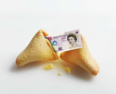 Broken fortune cookie with British Pound inside Stock Photo - 16092037