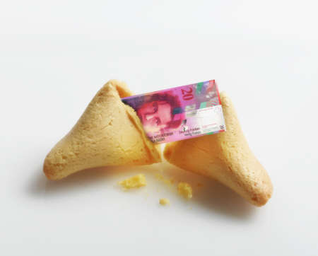 Broken fortune cookie with Swiss Franc inside Stock Photo - 16092038