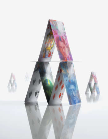 precarious: Pyramid made of Swiss Francs and playing cards