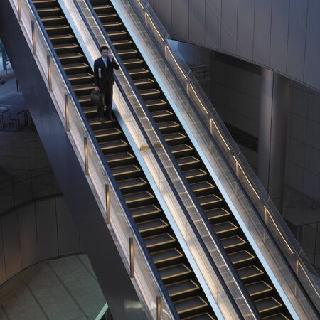 Businessman with briefcase on escalator Stock Photo - 16092061