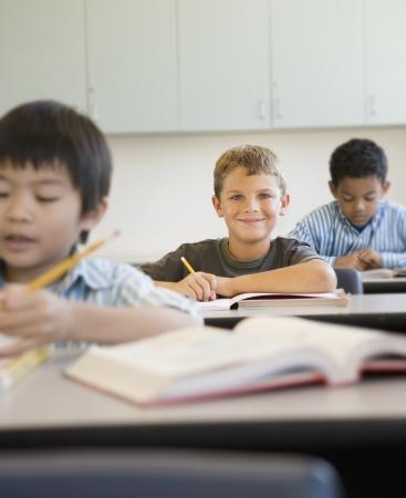 Students working at desks in classroom Reklamní fotografie