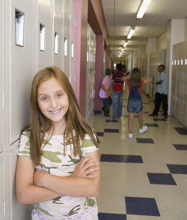 Young girl smiling in school hallway Stock Photo - 16092254