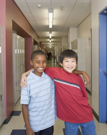 Young boys smiling in school hallway Stock Photo - 16092256