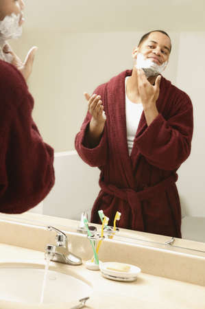 African man applying shaving cream to face Stock Photo - 16092265