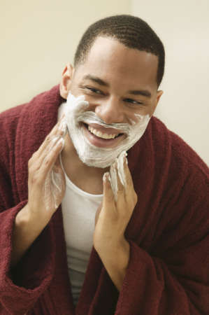 African man applying shaving cream to face Stock Photo - 16092266