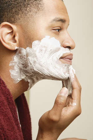 African man applying shaving cream to face Stock Photo - 16092267
