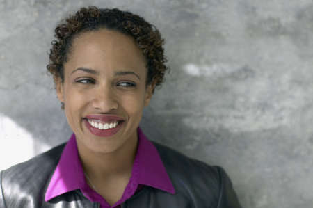 jamaican ethnicity: Close up of African woman smiling LANG_EVOIMAGES